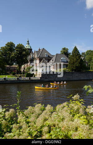 St. Johannis monastery, kayakers on the Alster river, seen from Leinpfad walkway, Hamburg, Hamburg, Germany - Stock Photo
