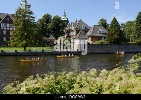 St. Johannis monastery, kayakers paddling on the Alster river, Leinpfad walkway, Hamburg, Hamburg, Germany - Stock Photo