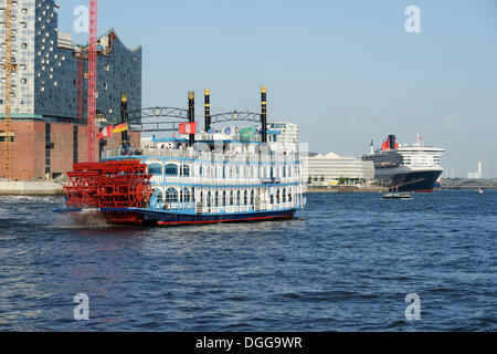 Paddle steamer, RMS Queen Mary 2 visiting during Hamburg Cruise Days, Port of Hamburg with the Elbe Philharmonic - Stock Photo
