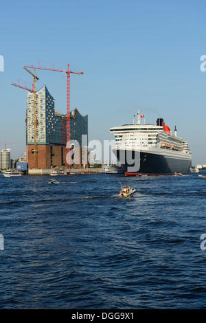 Cruise liner RMS Queen Mary 2 leaving the harbour, Elbe Philharmonic Hall under construction, Hamburg, Hamburg, - Stock Photo