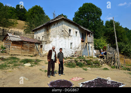 Albanian family in front of their old farmhouse in Cerem, Valbona National Park, Albanian Alps, Albania, The Balkans, - Stock Photo