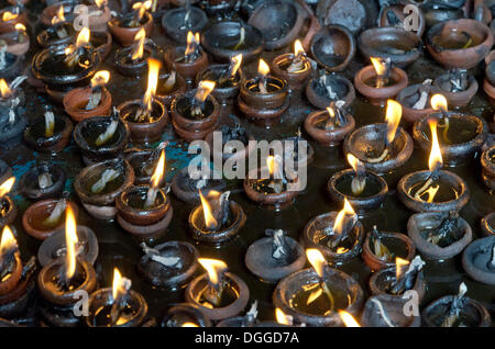 Hundreds of little oil lamps burning inside the Menakshi-Sundareshwara Temple in Madurai, India, Asia - Stock Photo