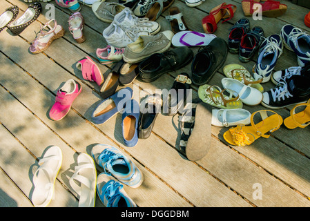 Large group of shoes on wooden planks - Stock Photo