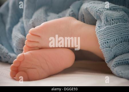 Baby boy 's feet, close up - Stock Photo