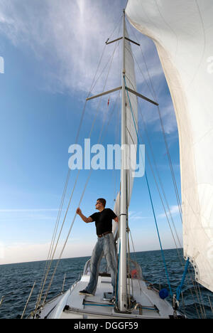 Skipper standing on deck of his yacht - Stock Photo