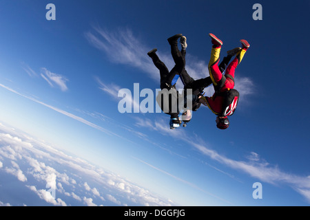 Formation skydivers free falling upside down - Stock Photo