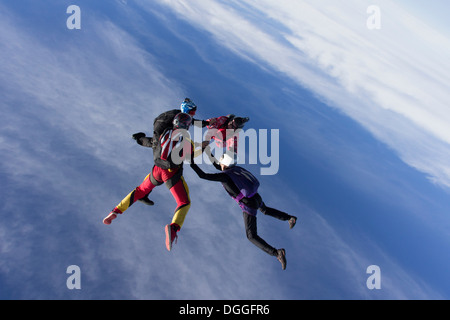 Small group of skydivers in formation - Stock Photo