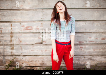 Portrait of young woman laughing - Stock Photo