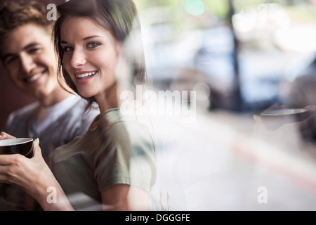 Young couple inside cafe - Stock Photo