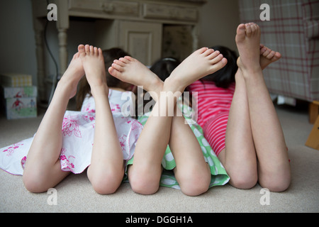 close up of a young girls feet wearing ballet shoes stock photo