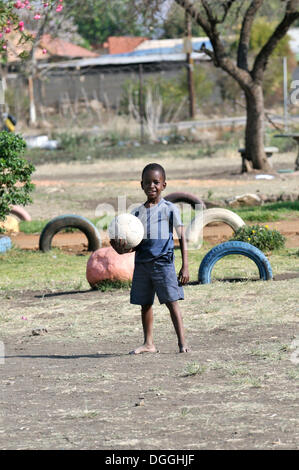 Boy holding a football, Cape Town, South Africa, Africa - Stock Photo