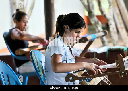 Crafts, women weaving table mats with dried banana leaves, settlement of the Brazilian Landless Workers' Movement - Stock Photo