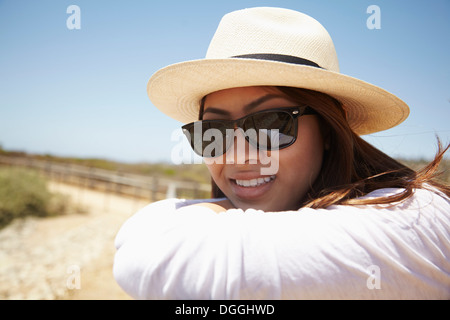 Young woman wearing sunglasses, Palos Verdes, California, USA - Stock Photo
