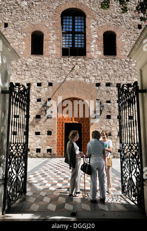 Women talking in front of the main entrance of the Jesuit church of Compania de Jesus, Unesco World Heritage, Cordova, - Stock Photo