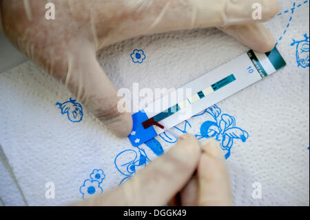 AIDS rapid test with a drop of blood that is taken from the fingertip, Masaya, Departamento Masaya, Nicaragua - Stock Photo