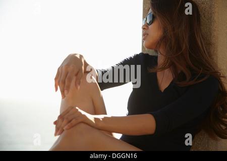 Young woman relaxing, Palos Verdes, California, USA - Stock Photo