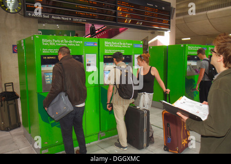 Paris France Europe French CDG Charles de Gaulle Airport ticket vending machine self service train RER Metro man - Stock Photo