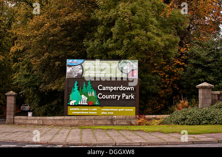 Large sign at the main entrance of the Camperdown Country Park surrounded by colourful trees during Autumn in Dundee, - Stock Photo