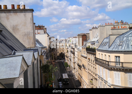 Paris France Europe French 9th arrondissement Rue la Bruyere rooftops historic Haussmann apartment buildings chimneys - Stock Photo