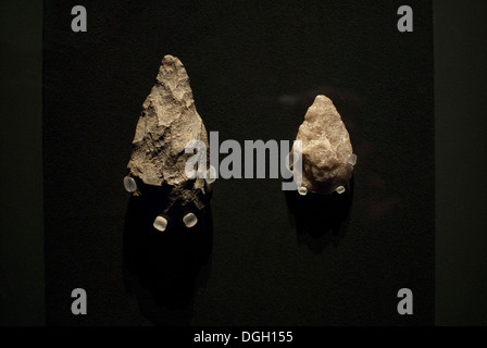 Quartz and lava bifaces from early Stone Age. Olduvai Gorge, Tanzania. 1.6 - 1.7 millions of years B.C. - Stock Photo