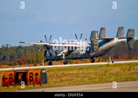 A U.S. Navy C-2A Greyhound from VAW-120 lands at Atlantic City International Airport, N.J. for a 'touch and go' - Stock Photo