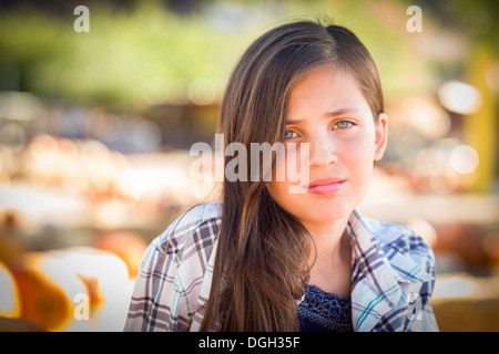 Preteen Girl Portrait at the Pumpkin Patch in a Rustic Setting. - Stock Photo