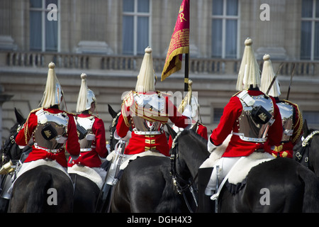 Household Cavalry mounted troopers in ceremonial uniforms 'Changing of the Guard' outside palace Buckingham Palace - Stock Photo