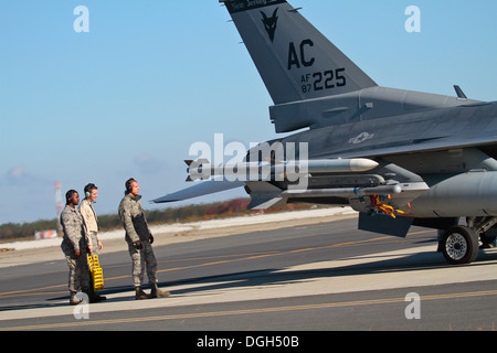 U.S. Air Force airmen from the New Jersey Air National Guard's 177th Fighter Wing 'Jersey Devils,' prepare for a - Stock Photo