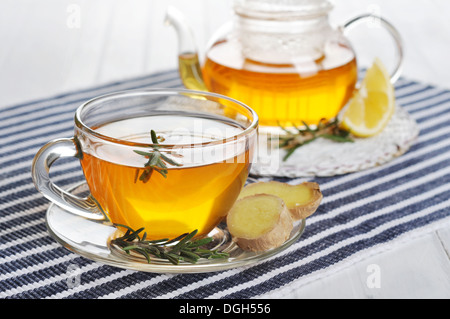 Ginger tea with lemon and rosematy in glass cup closeup. - Stock Photo