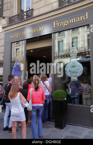 Paris France Europe French 9th arrondissement Rue Scribe Fragonard Perfume Museum Musee du Parfum line queue customers - Stock Photo