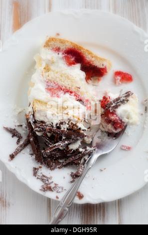 Strawberry stracciatella cake with chocolate curls on top - Stock Photo
