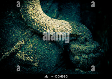 Detail of stone statue in Candi Sambisari,showing part of an elephant trunk. - Stock Photo