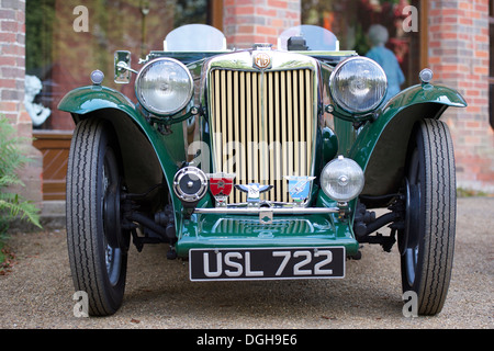 Vintage MG Roadster in British Racing Green - Stock Photo
