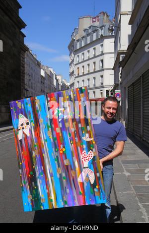 Paris France Europe French 9th arrondissement Rue Flechier man artist painting - Stock Photo