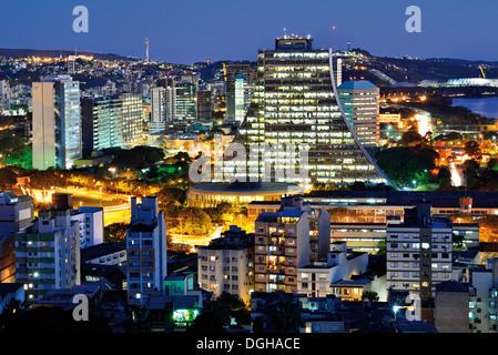 Brazil, Rio Grande do Sul: Nocturnal panorama over the roofs of state capital  Porto Alegre - Stock Photo