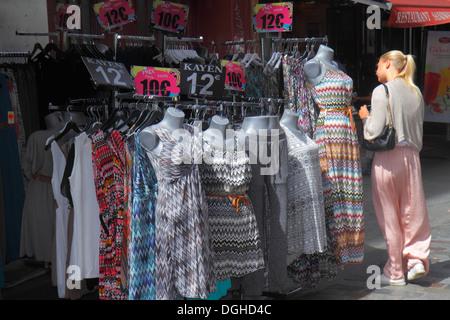Paris France Europe French 9th arrondissement Rue de Caumartin shopping woman clothing dresses pricing Euros - Stock Photo