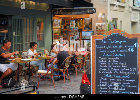 Paris France Europe French 18th arrondissement Montmatre Place du Tertre restaurant cafe brasserie tables chairs - Stock Photo