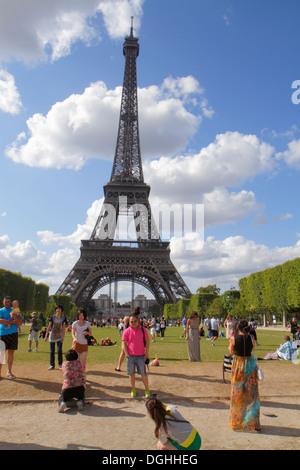 Paris France Europe French 7th arrondissement Parc du Champ de Mars Avenue Joseph Bouvard Eiffel Tower Asian man - Stock Photo