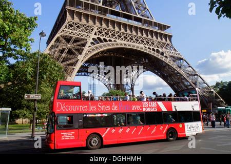 Paris France Europe French 7th arrondissement Quai Branly Eiffel Tower base legs pillars double decker bus motor - Stock Photo