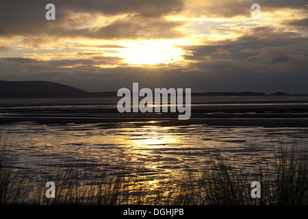 View across estuary at sunset, River Loughor, from Llanelli to Gower Peninsula, Carmarthenshire, Wales, January - Stock Photo