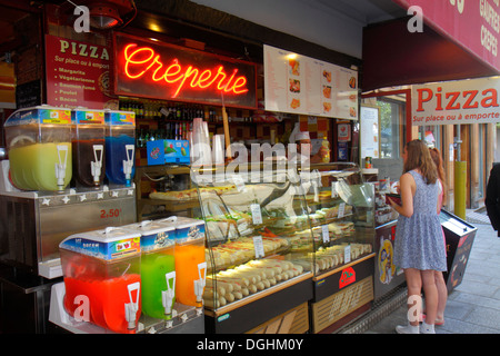 Paris France Europe French 2nd arrondissement Rue Rambuteau food vendor stand creperie crepes drinks counter customer - Stock Photo
