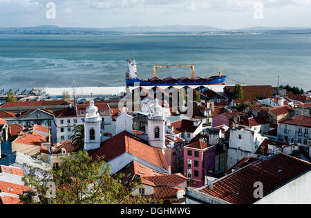 View from Miradouro Santa Luzia over the Alfama district on the Tagus river, Lisbon, Portugal, Europe - Stock Photo
