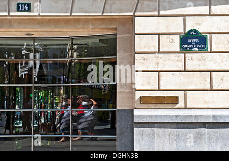 Reflection in a shop window on the Champs Elysees, Paris, Ile de France region, France, Europe - Stock Photo