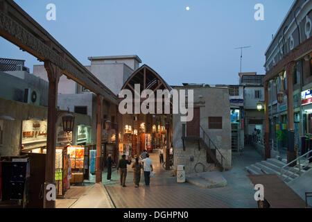 Street scene in old souq of Dubai in the evening, Dubai, United Arab Emirates, Middle East - Stock Photo