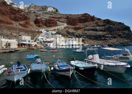 Fishing boats in the Ammoudi Harbour, Ammoudi Bay in Oia, Oía, Santorin, Cyclades, Greece - Stock Photo