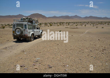 Safari vehicle in the Hoarusib river valley, Purros, Kaokoland, Kunene, Namibia - Stock Photo