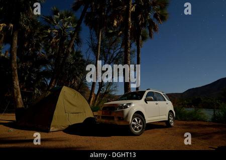 Tent and safari vehicle at night on a campsite near Epupa Falls, Epupa, Kaokoland, Kunene, Namibia
