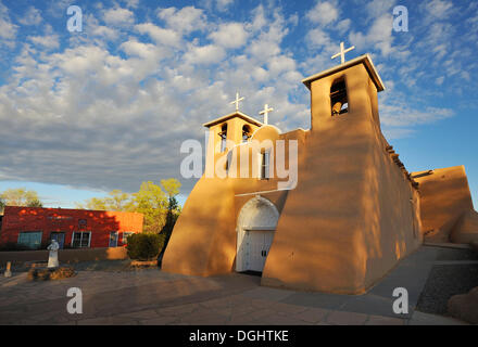 Adobe architecture, Church of St. Francis of Assisi, Ranchos de Taos, New Mexico, USA - Stock Photo
