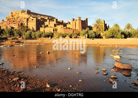 The Kasbah and the fortified city or ksar Ait Ben Haddou reflected in the Asif Mellah river, High Atlas, Ait Ben - Stock Photo