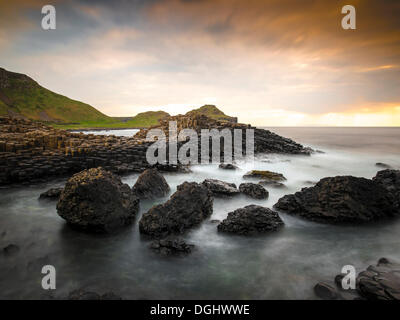 Basaltic rocks on the shore with waves, Giant's Causeway, Coleraine, Northern Ireland, United Kingdom, Europe - Stock Photo